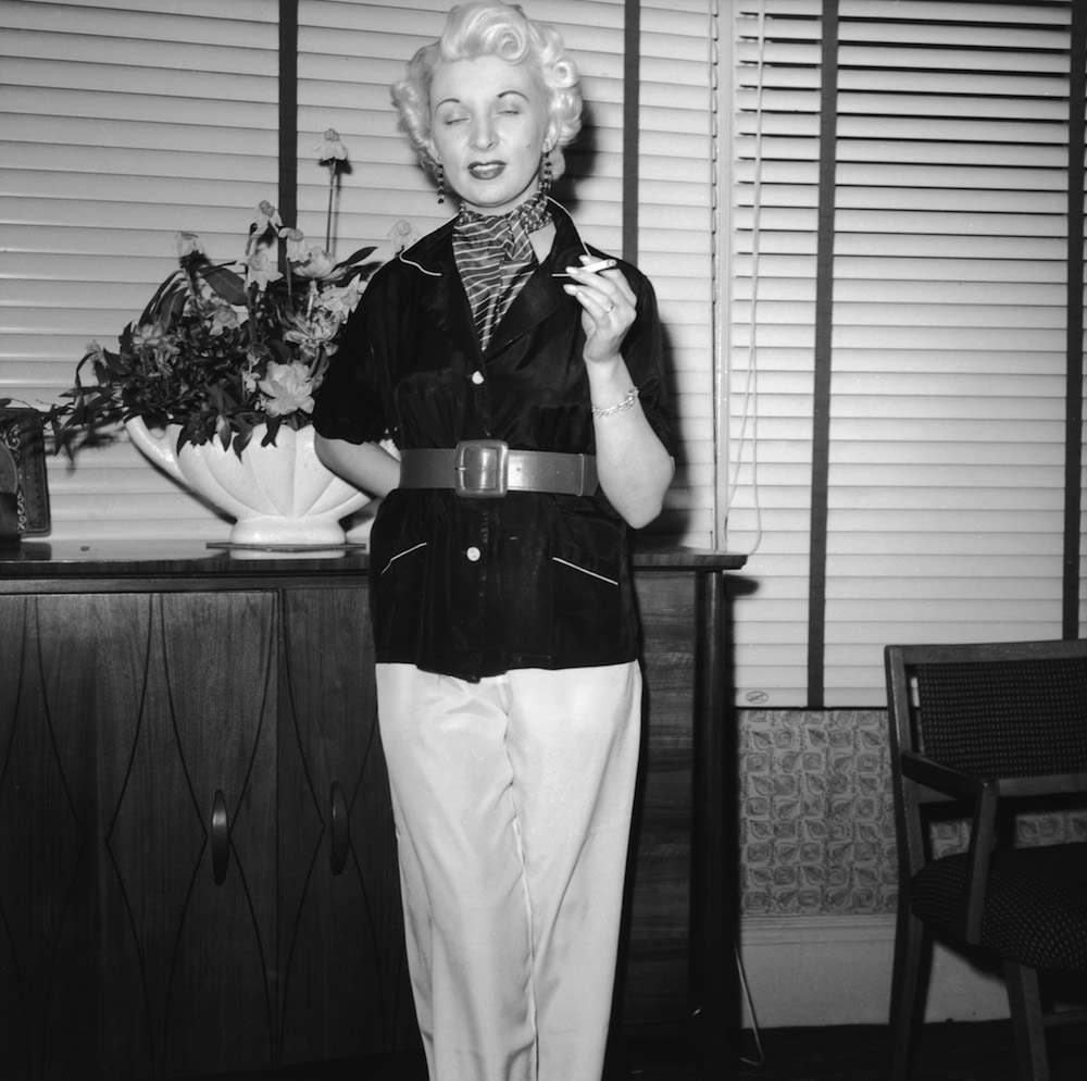 Night club manageress Ruth Ellis (1926 - 1955) poses for one Captain Ritchie, 1954. The setting is probably the flat above her club on the Brompton Road in Knightsbridge, London. In 1955, Ellis was convicted of the murder of her lover, David Blakely, and hanged at Holloway Prison, becoming the last woman to receive the death penalty in Britain. (Photo by Hulton Archive/Getty Images)