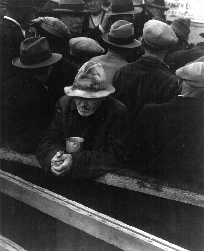A man waiting at a breadline in San Francisco during the Winter of 1933. (Photo by Dorothea Lange/National Archive/Newsmakers)