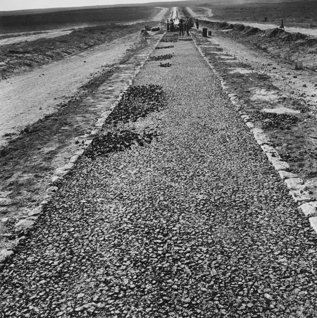 A new road under construction in the Negev Desert, Israel, circa 1950. Roads are being built in preparation for new settlement in the region. (Photo by George Pickow/Three Lions/Hulton Archive/Getty Images)