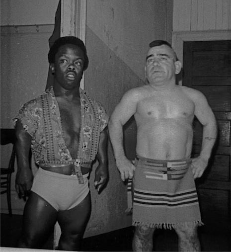 Jamaica Kid and Little Beaver backstage at a wrestling arena April 25, 1969. Little Beaver was born Lionel Giroux in Saint-Jérôme, Quebec in 1935. he began his wrestling career at the age of fifteen and teamed up with fellow Canadian Sky Low Low, the pair going on to become two of the most famous wrestlers in history. He went on to win a clutch of wrestling awards including the NWA Midget Wrestling Championship twice and was a firm favorite with fans.