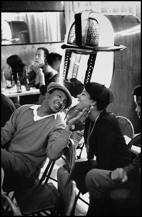 South Africa. Gauteng. Johannesburg. Fordsburg. Affection between two people in a multi-racial cafe. 1961 (C)Ian Berry / Magnum Photos No photograph or digital file may be reproduced, cropped or modified (digitally or otherwise), and the spirit of the caption must be respected.