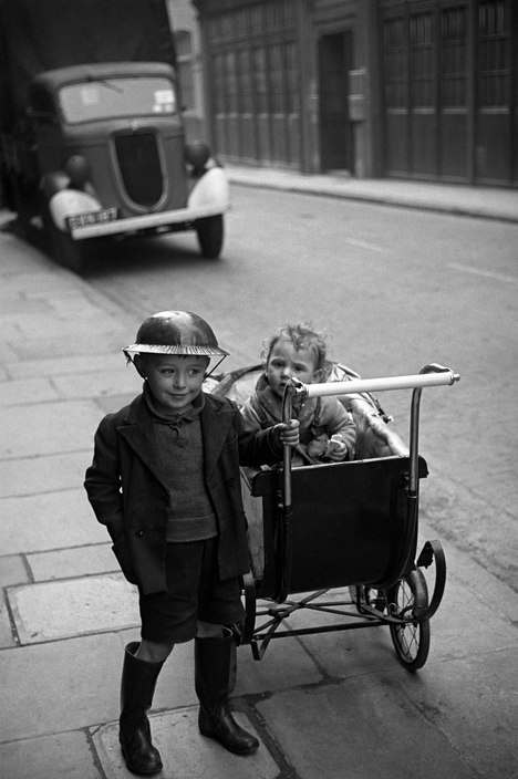 G.B. ENGLAND. London. Steel helmets were worn by all who could get them. Life in London during The Blitz of World War II in1939-40. 1940.