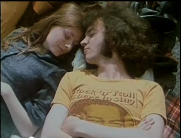 /Sleeping youth in UA Records Fats Domino Rock N Roll Is Here To Stay t-shirt. Still from Peter Clifton's London Rock N Roll Show//