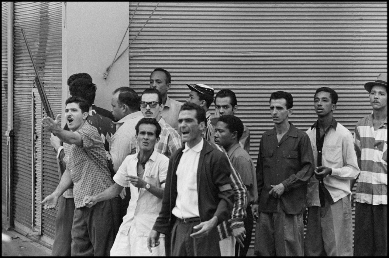 CUBA. La Havana. 1959. On new year's days, CASTRO sympathizers form an adhoc militia and secure whatever buildings are available. No photograph or digital file may be reproduced, cropped or modified (digitally or otherwise), and its caption may not be altered without prior written agreement from the photographer or a Magnum representative.