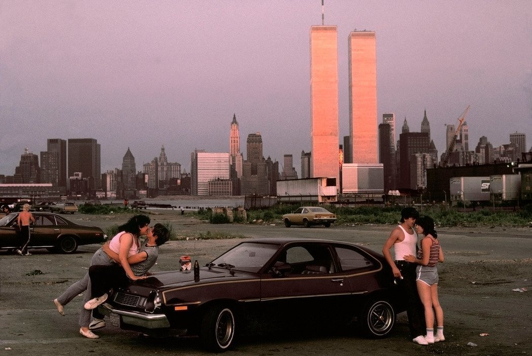 "USA. New Jersey. 1983. Downtown Manhattan with World Trade Center towers, seen from ""lover's lane' in New Jersey."