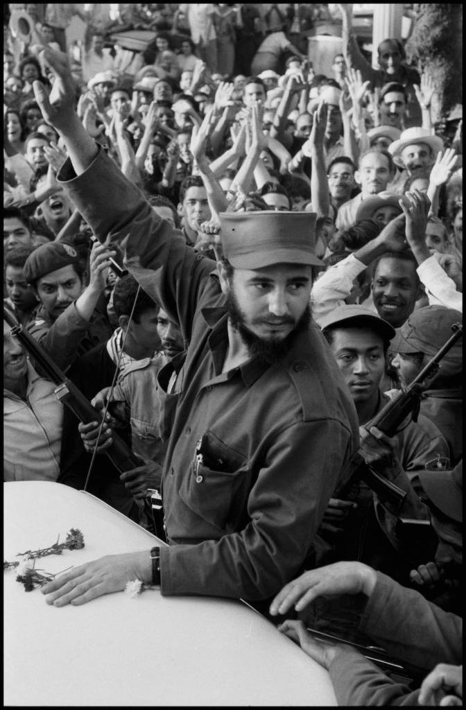 CUBA. 1959. Times of euphoia as Fidel CASTRO and his army tries to drive through the city of Ciefuego, on their way to liberate Havana.