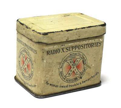 "An empty tin that once contained radioactive suppositories. That they were radioactive is indicated by the presence of radium in a similar product manufactured by the same company: Radio X Tablets. The manufacturer, the Radium Remedies Company, was located in Pittsburgh, PA. Other ""Radio-X"" products of the Radium Remedies Company included Tablets, Ointment, Complexion Soap, Asthma Pads and Radium Emanation Water. The Radio X pad was promoted by the singer Al Jolson who claimed that it ""worked wonders"" for his throat. The company, which seems to have operated from 1917 or so to 1929, was owned by Robert McKnight whom the company literature described as an ""eminent American Chemist."" Size: 1.75"" x 1.5"" x 1.2"""