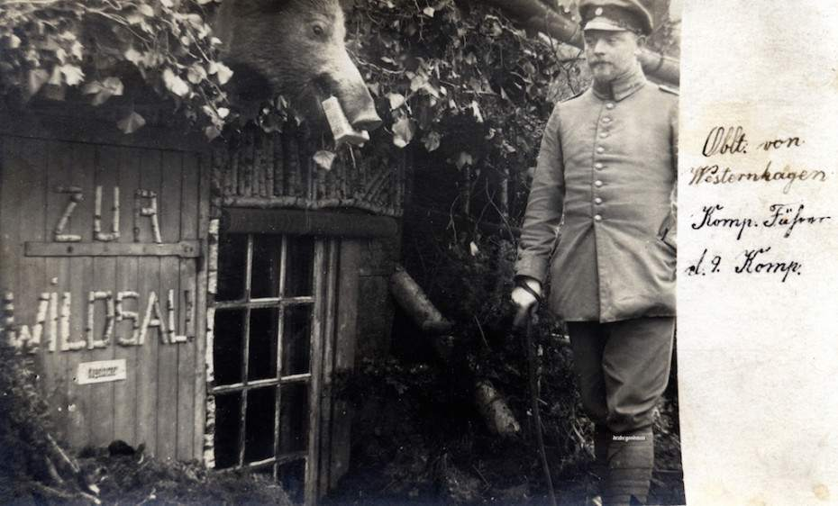 "The company commander's bullet-proof (""kugelsicher"") bunker or hut is called ""Zur Wildsau"" (the name of a pub ""The Boar's Head"") to match the stuffed wild boar's or sow's head above the entrance. Not sure what is stuck in the animal's mouth. (c) Drake Goodman."