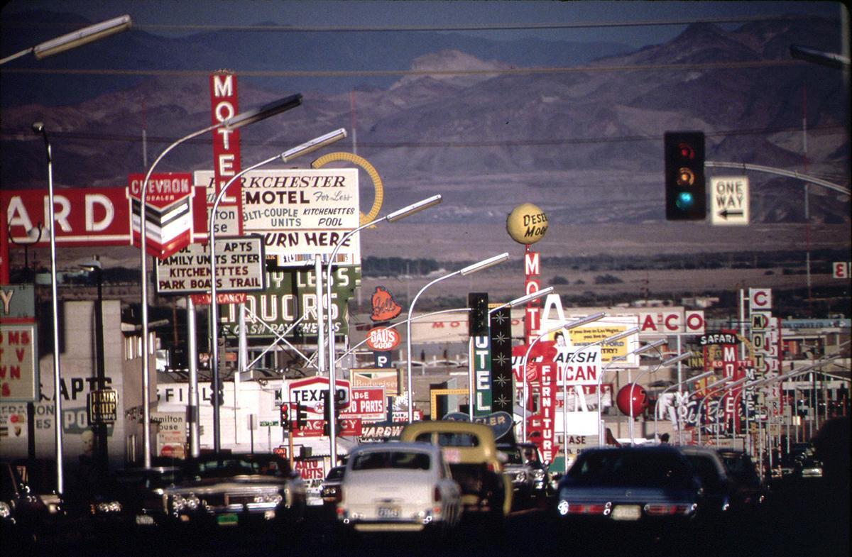 Signs crowd the roadway in this Las Vegas street scene, shot in May of 1972. # Charles O'Rear/NARA