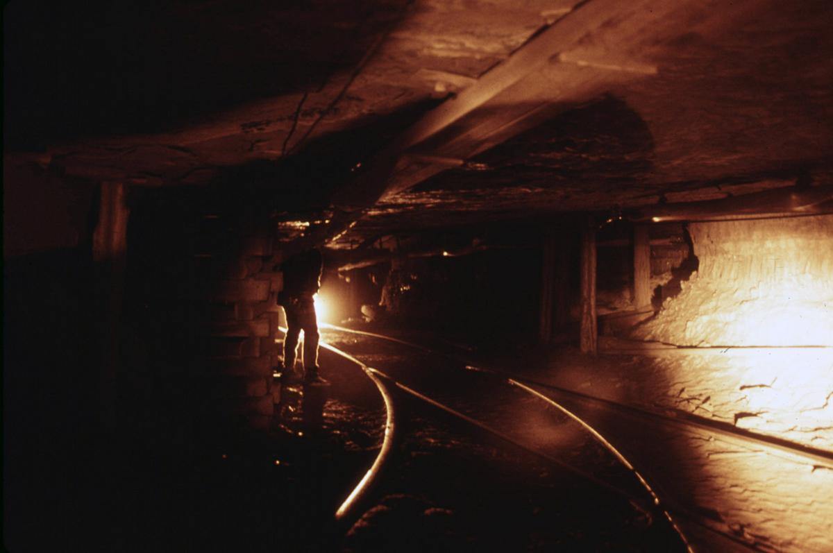 Underground in the Virginia-Pocahontas Coal Company Mine #3, near Richlands, Virginia, in April 1974. The tunnel is 1,250 feet below the surface and one-and-a-half miles from the elevator shaft that brings the miners to and from work. # Jack Corn/NARA