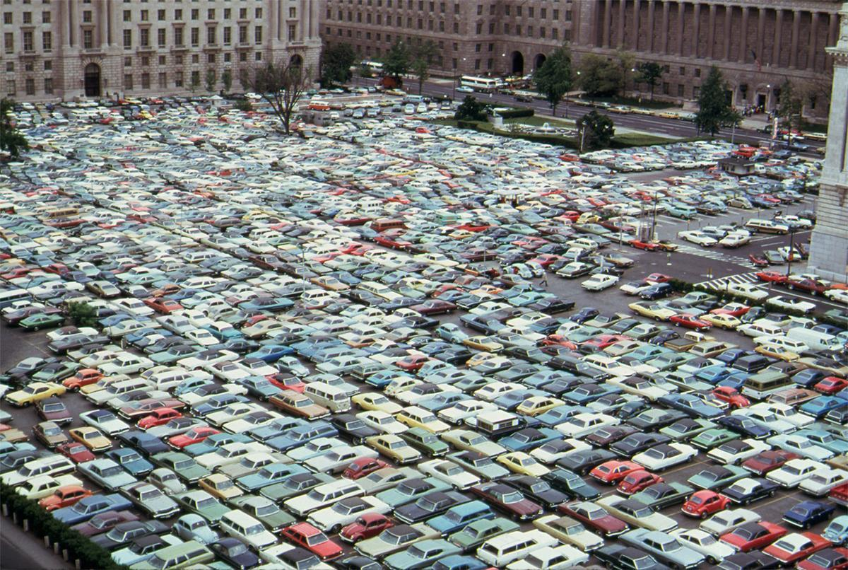 Cars were jammed even more than usual into every spare space at a downtown commercial parking lot during a bus strike in Washington, District of Columbia, in May 1974. Some 250,000 people were forced to find alternate forms of transportation. Monumental traffic jams resulted as drivers learned there were more cars than legal places to park. # Jim Pickerell/NARA