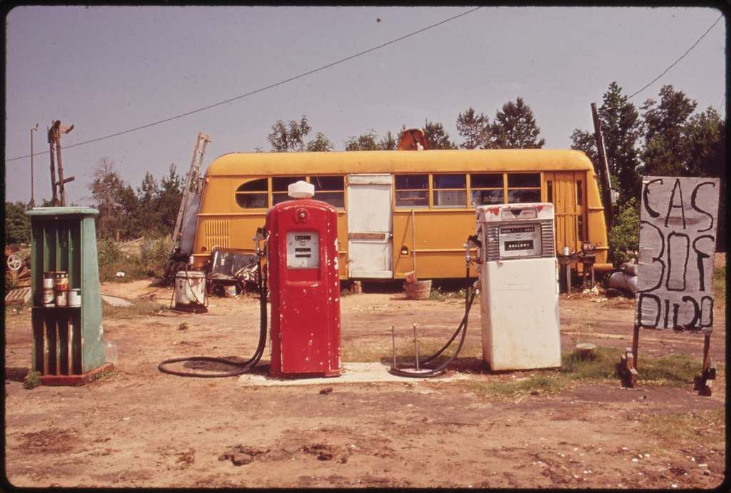 Cut-Rate Gas Station Operates Out of Bus, 06/1972 Original Caption: Cut-Rate Gas Station Operates Out of Bus, 06/1972 U.S. National Archives' Local Identifier: 412-DA-3666 Photographer: St. Gil, Marc, 1924-1992 Subjects: Marshall (Harrison county, Texas, United States) inhabited place Environmental Protection Agency