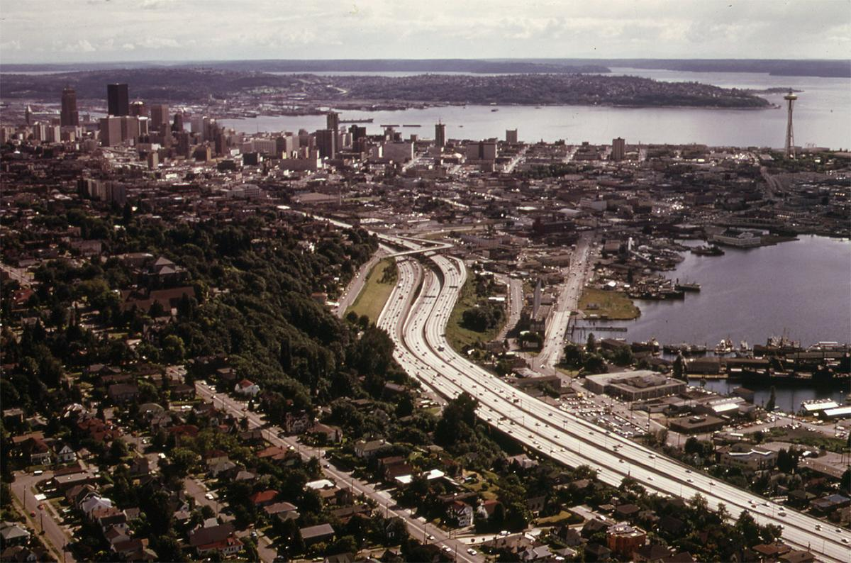 The City of Seattle and Interstate Highway 5, with Elliott Bay at right, seen in June of 1973. # Doug Wilson/NARA