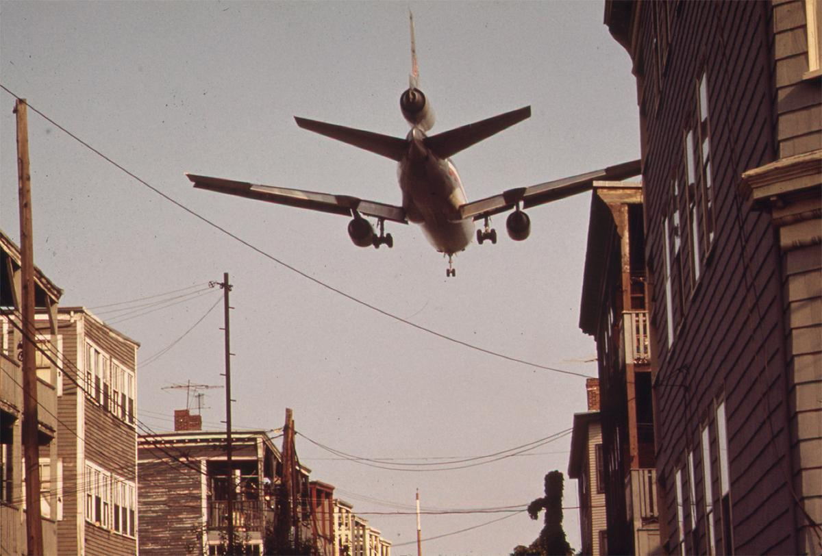 Near Boston's Logan Airport, an airplane comes in for a landing over homes on Neptune Road in May of 1973. # Michael Philip Manheim/NARA