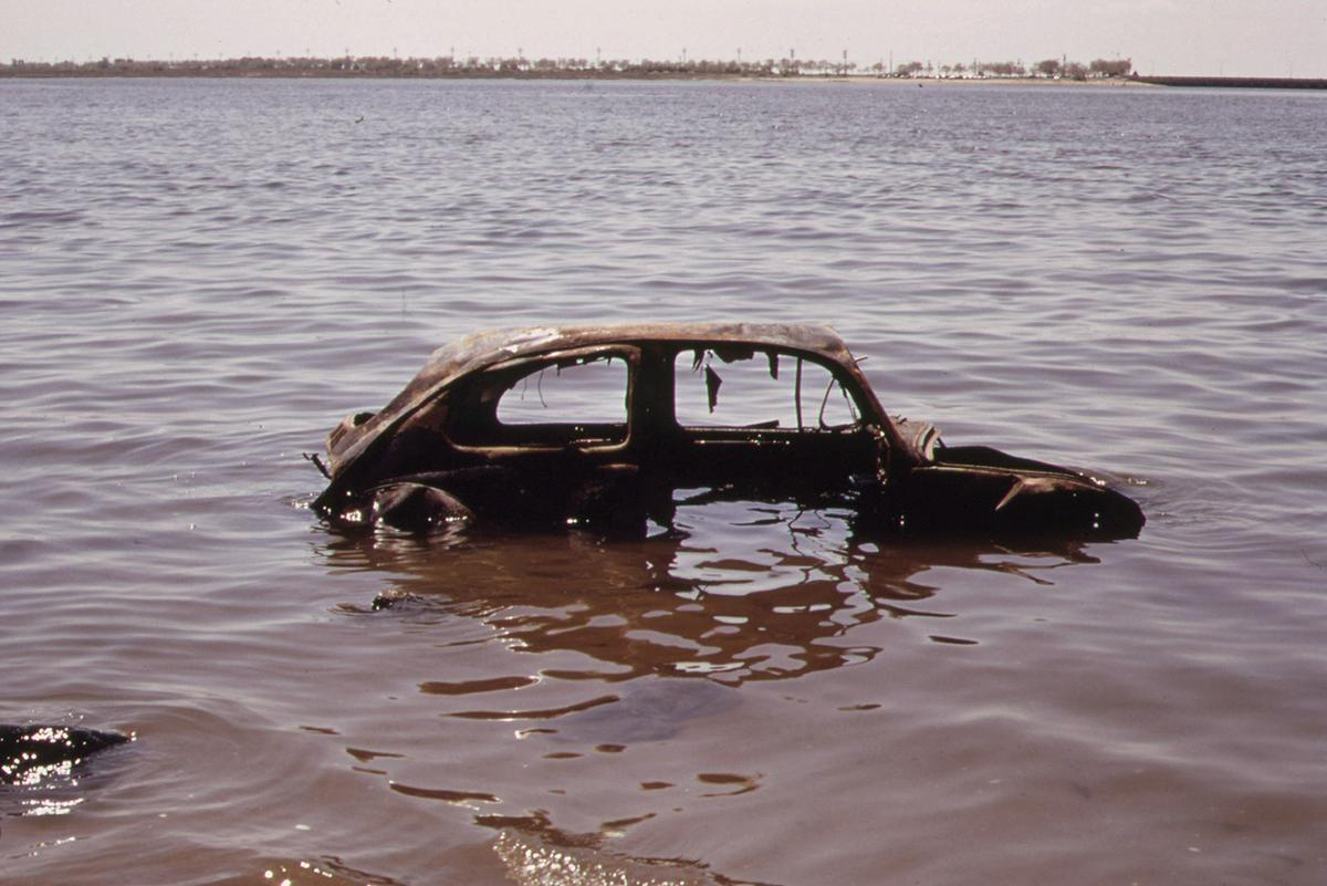 An abandoned car sits in New York's Jamaica Bay, in June of 1973. # Arthur Tress/NARA