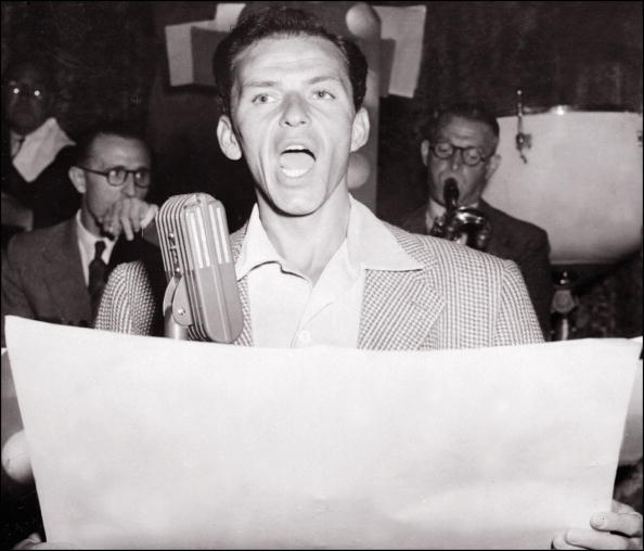 LONDON, ENGLAND: Legendary US singer Frank Sinatra in a picture taken 07 March 1950 in London performs on stage at Palladium Theater. Frank Sinatra, born 12 December 1915, was a playboy who married four times, twice to famous actress, Ava Gardner and Mia Farrow. But he was deeply attracted to the actress; his biographer Kitty Kelley wrote that Gardner was the only woman he respected because he knew he could not dominate her. Sinatra got married for the last time in 1976 to Barbara Marx, widow of comedian Zeppo Marx of the four Marx brothers. Sinatra number his conquests, according to Kelley, among Hollywood's greatest beauties, including Marlene Dietrich, Judy Garland, Natalie Wood, Elizabeth Taylor and Victoria Principal. (Photo credit should read AFP/AFP/Getty Images)