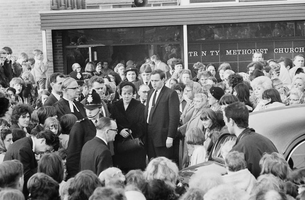 Ann Downey (centre, left), mother of 10 year-old murder victim Lesley Ann Downey, at her daughter's funeral, 3rd November 1965. Downey was murdered on 26th December 1964, by Moors murderers Ian Brady and Myra Hindley. (Photo by Evening Standard/Hulton Archive/Getty Images)