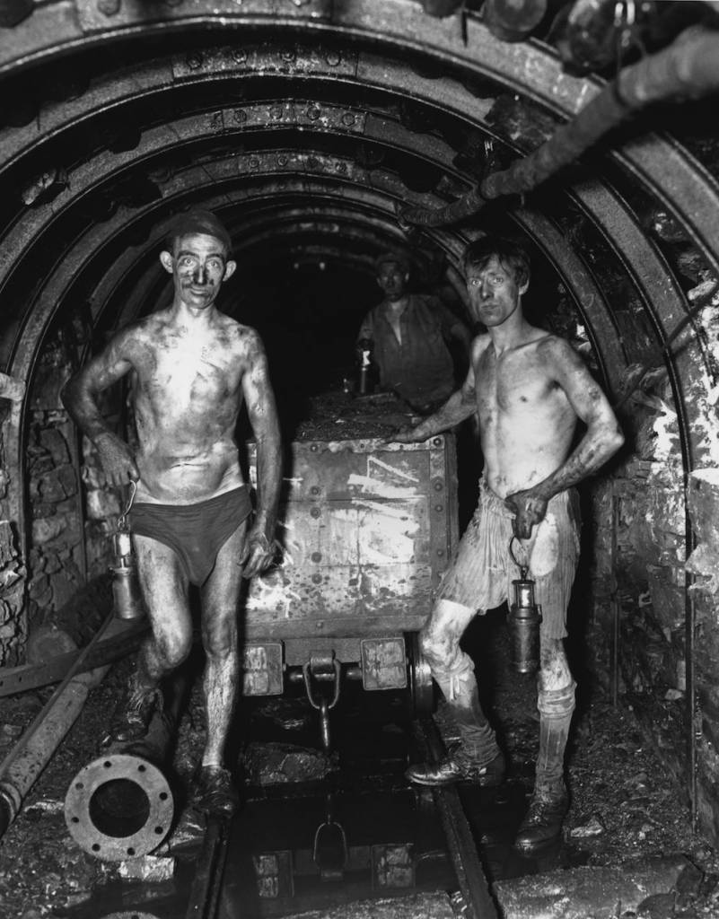 Two miners working in their underwear on the coal face at Tilmanstone Colliery, Kent. This photograph was taken using a 'Sashalite', a safe flash light developed by the photographer Sasha.   (Photo by Sasha/Getty Images)