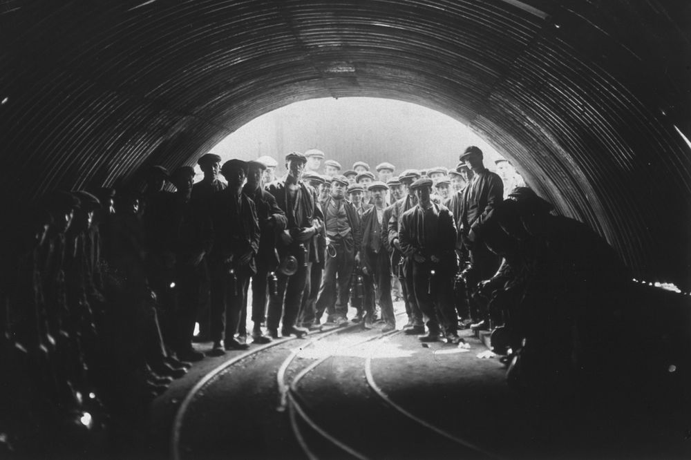 Coal miners standing at the pit head of Tilmanstone colliery, Kent. The picture was taken using a 'Sashalite', a safe photographic flash developed by Sasha himself. (Photo by Sasha/Getty Images)