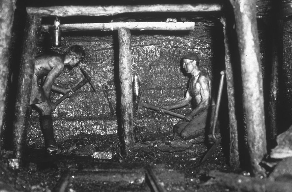 Miners working at the coal face of Tilmanstone colliery, Kent. The photograph was taken using a 'Sashalite', one of the first safe photographic flash guns, invented by Sasha himself. (Photo by Sasha/Getty Images)