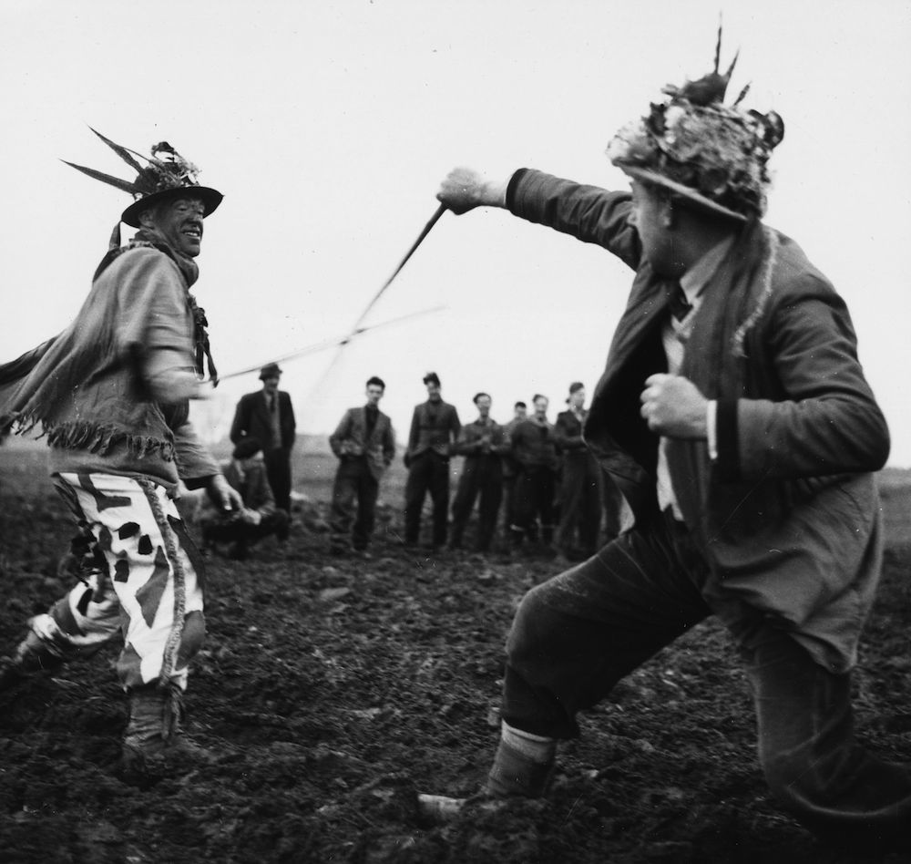 circa 1955: Two boggans fighting each other during the traditional Boxing Day ceremony at Haxey in Lincolnshire. (Photo by George Pickow/Three Lions/Getty Images)