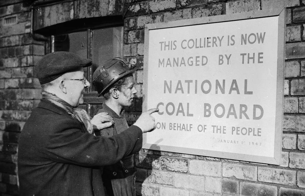 2nd January 1947: Two miners reading a notice announcing that their colliery is.. 'Now managed by the National Coal Board on behalf of the People'. (Photo by Keystone/Getty Images)