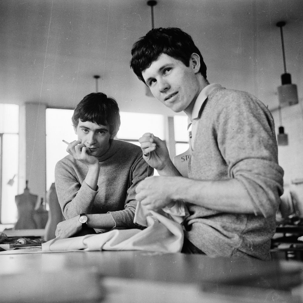 18th June 1965:  Fashion designer Ossie Clark (1942 - 1996, left) with Peter Morgan, a fellow student at the Royal School of Art and Fashion.  (Photo by Terry Disney/Express/Getty Images)