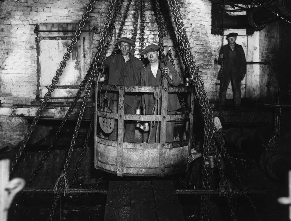 1930:  Using his newly developed Sashalight, photographer Sasha has taken this picture of coal miners in the emergency cage. The Sashalight is a new type of flash which is ignited by an ordinary battery, and so is safe to use in a mine, unlike previous flashes which used highly explosive flash powder.  (Photo by Sasha/Getty Images)
