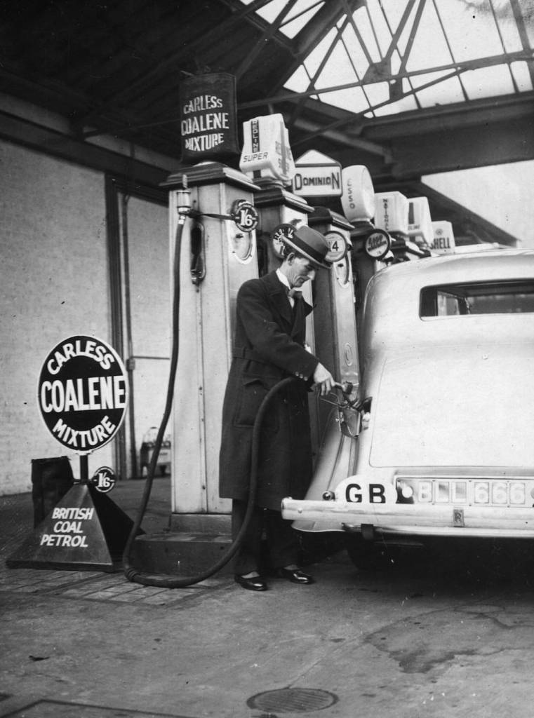 November 1935:  Tom Williams, MP  for Don Valley, fills up the first car with petrol from British coal at a service station in London. Williams represents the Doncaster miners, who hew the coal from which the petrol is distilled.  It is produced by the coalite carbonisation process.  (Photo by E. Dean/Topical Press Agency/Getty Images)
