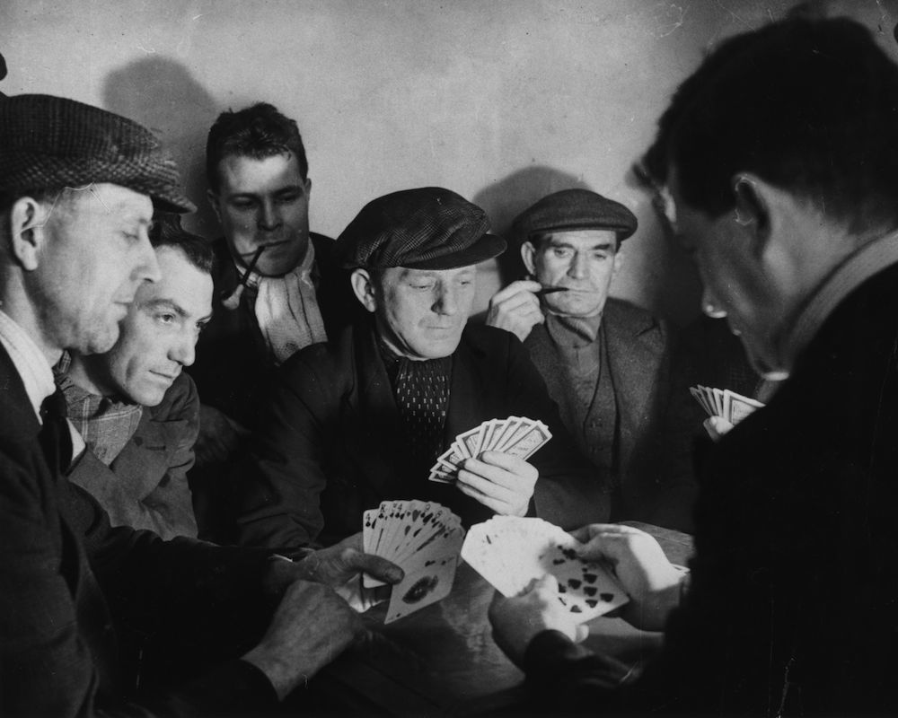 circa 1950: Some of the 1,000 men who have been on strike from the Nottinghamshire colliery of Haworth for nine weeks, playing a game of cards to while away the time. (Photo by Keystone/Getty Images)