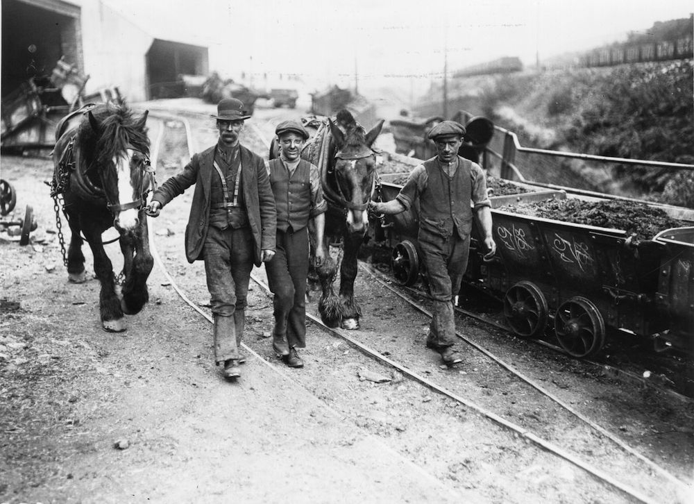 1st August 1915: Men with their ponies on the way to the pit mouth after the settlement of the 1915 coal strike. (Photo by Topical Press Agency/Getty Images)
