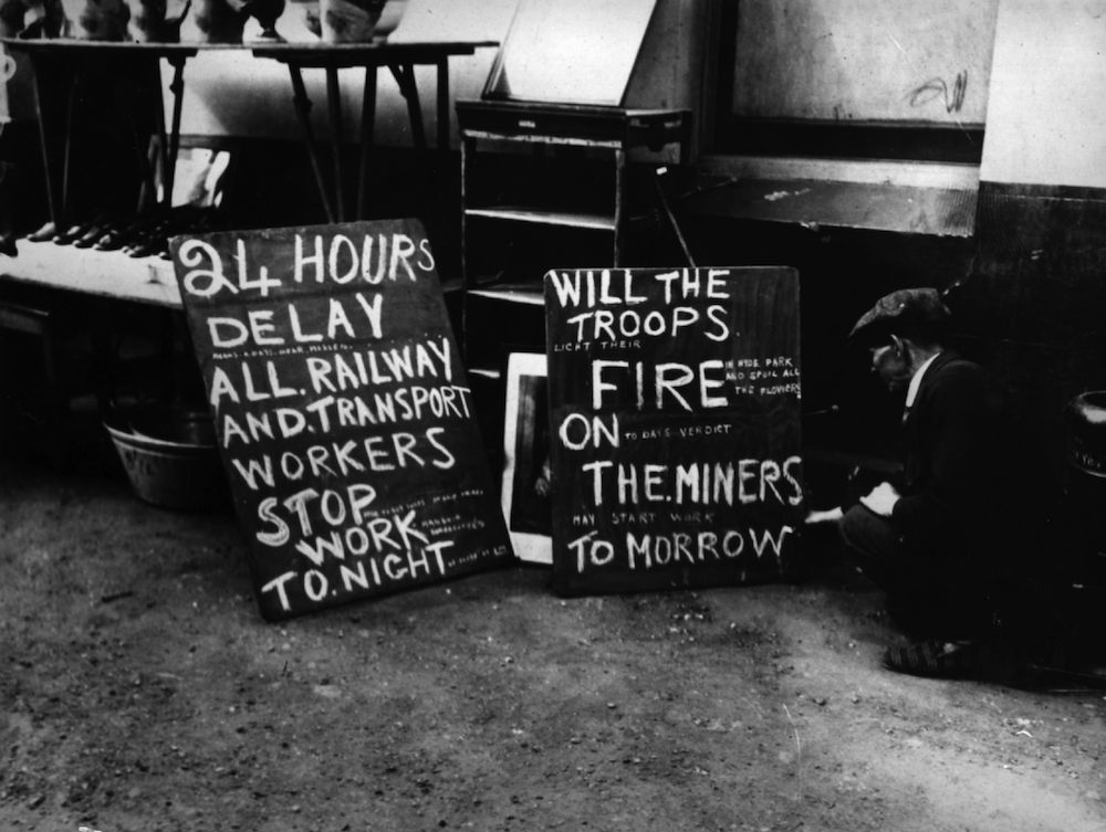 circa 1921: An enterprising tradesman's signs during the 1921 coal strike. (Photo by Topical Press Agency/Getty Images)