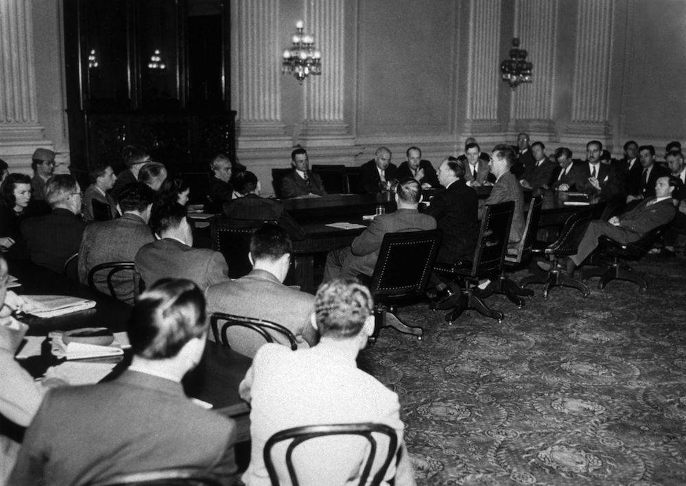 circa 1946: Former Communist Party leader, Louis F Budenz, at the US House Committee on Un-American Activities, where he asserted that the Soviet Union had a network organisation in America. Budenz can be seen in the middle of the photograph, in the centre of the three men with their backs to the camera. (Photo by Keystone/Getty Images)