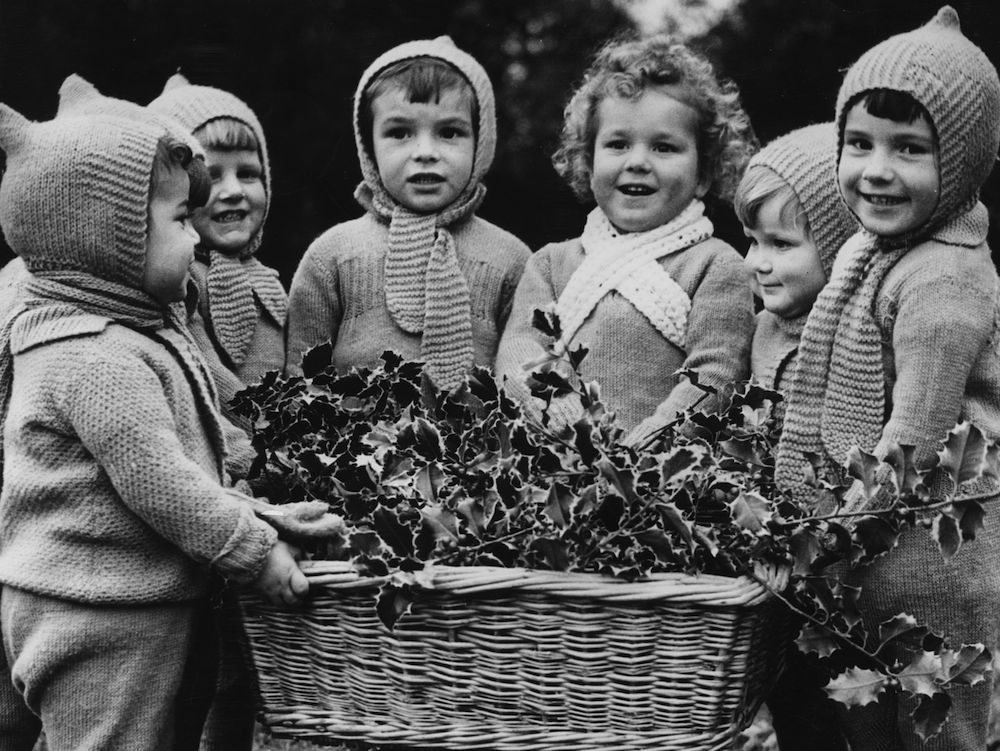 26th November 1942: Some of the children at the Dr Barnardo's Home at Farm Hill with the holly they have collected to decorate their home for Christmas. (Photo by Harry Shepherd/Fox Photos/Getty Images)