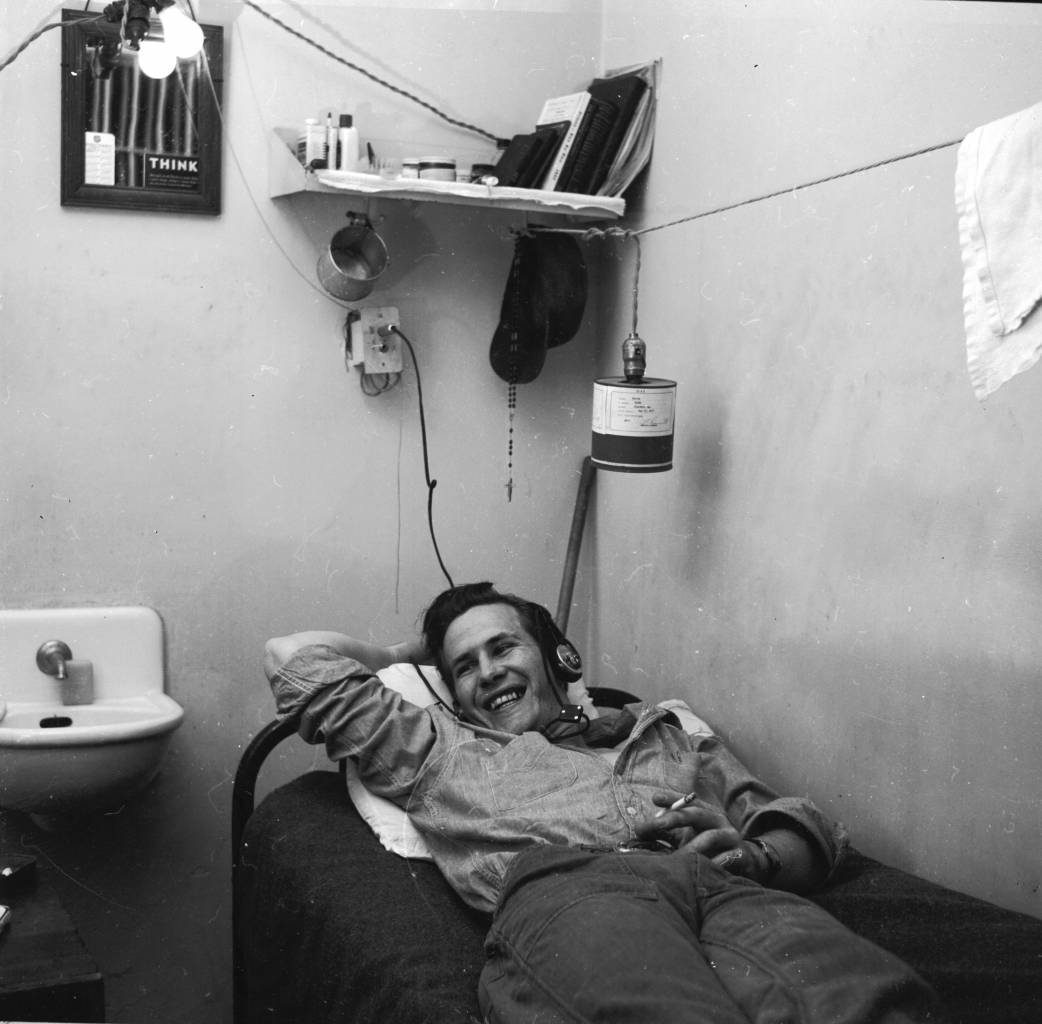 circa 1956: Prisoner Paul Harris listens to the radio in his cell at Iowa State Prison. (Photo by Three Lions/Getty Images)