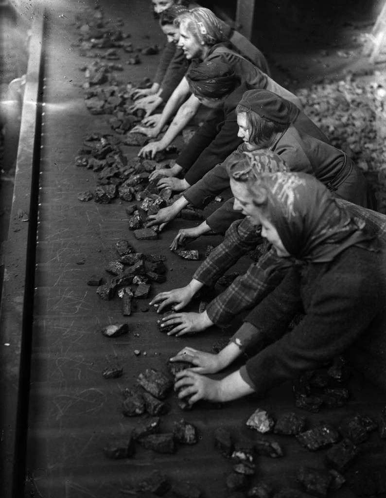 1942: Women sorting coal on a conveyor belt. (Photo by Express/Express/Getty Images)