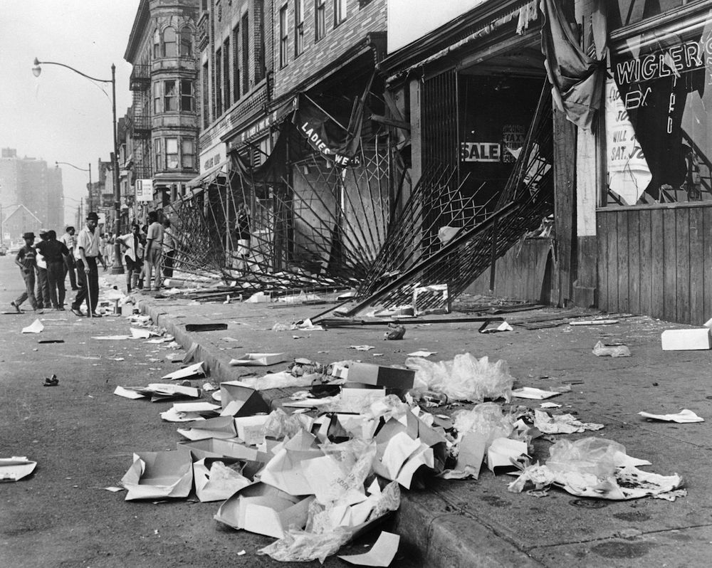 1967: Heavy metal gratings which failed to protect shop windows during the race riots in Detroit. The rioters later burned the shops they had looted. (Photo by Three Lions/Getty Images)
