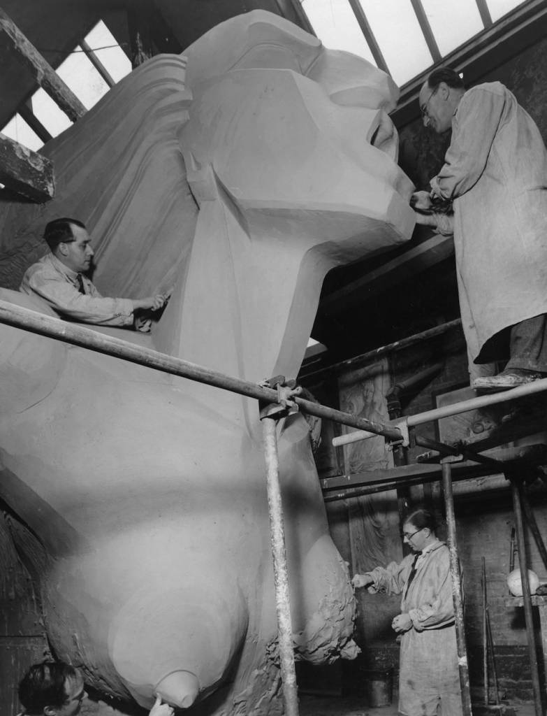 6th December 1934: One of three enormous figures depicting, 'Speed' created by Barney Seale being constructed by his assistants for the Chelsea Arts Ball at the Royal Albert Hall. (Photo by Fox Photos/Getty Images)