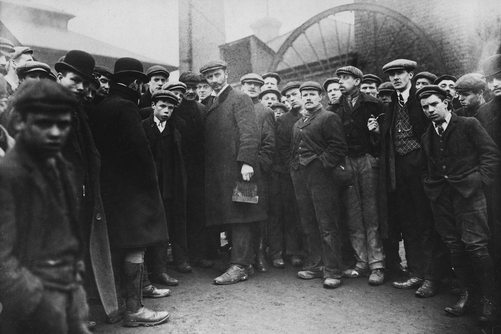 February 1908: A crowd of miners waiting anxiously for survivors of a disaster at Hampstead Colliery to surface from the coal face. (Photo by Topical Press Agency/Getty Images)