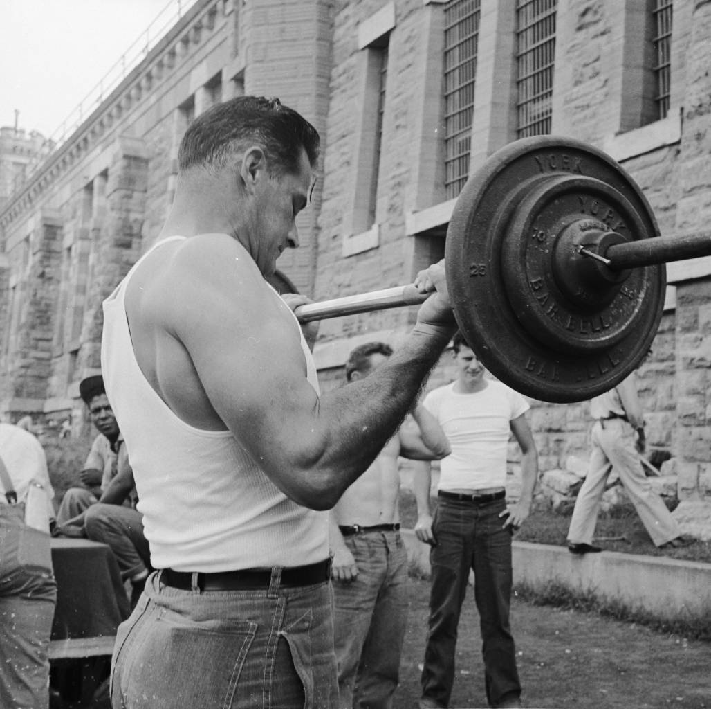circa 1956: A prisoner weightlifting at Iowa State Prison. (Photo by Neese/Three Lions/Getty Images)