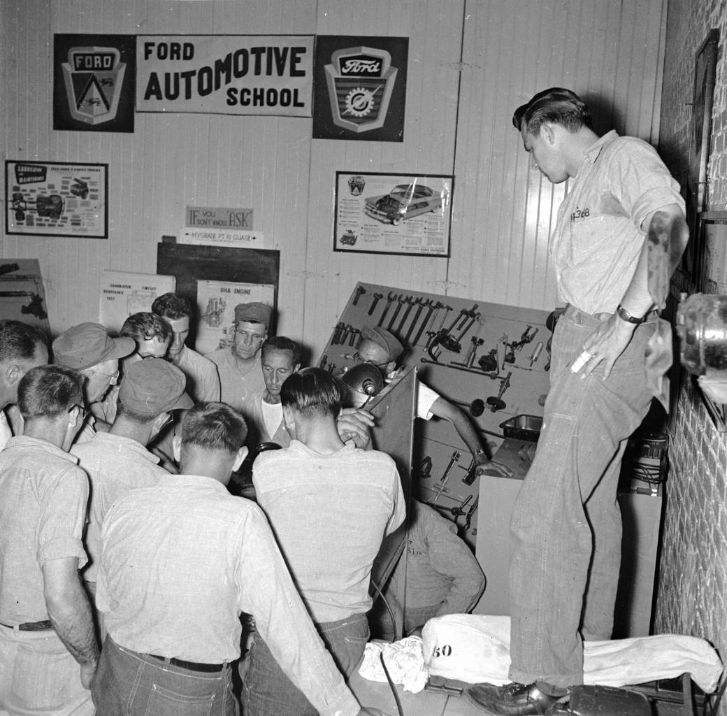 circa 1958: Inmates at Fort Madison, Iowa State prison, learning motor mechanics at a Ford sponsored school on the prison premises. (Photo by Three Lions/Getty Images)