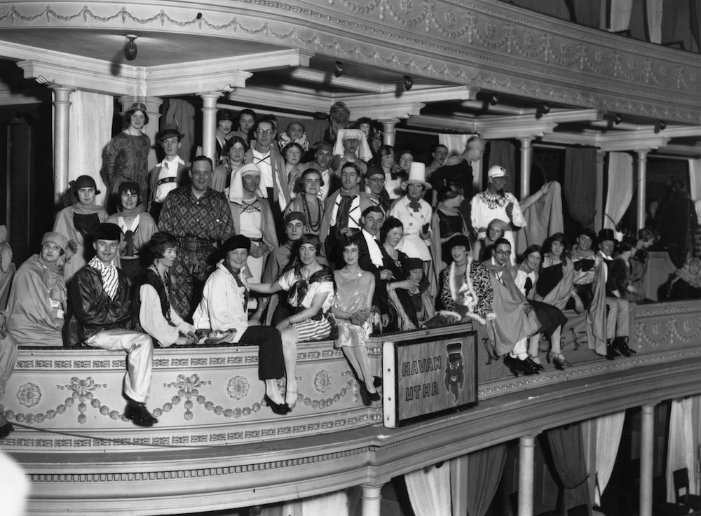 1926: Guests wearing various costumes at the Annual Chelsea Arts Ball in the Albert Hall, London. (Photo by Topical Press Agency/Getty Images)