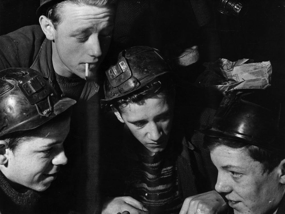 circa 1935: Coal miners in safety helmets at Ashington Colliery, in Northumberland. (Photo by Fox Photos/Getty Images)