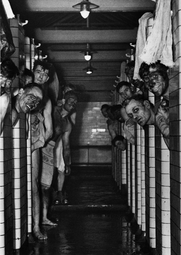 circa 1940: Miners taking a shower following a shift down the coal pit. (Photo by Fox Photos/Getty Images)