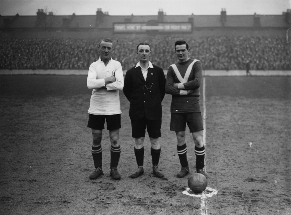 26th December 1925: From left to right : Bradford of Birmingham City, referee Mr Crew, and Clay of Tottenham Hotspur, before the kick off at White Hart Lane. All three had played together on the same team as amateurs before achieving professional status. (Photo by H. F. Davis/Topical Press Agency/Getty Images)