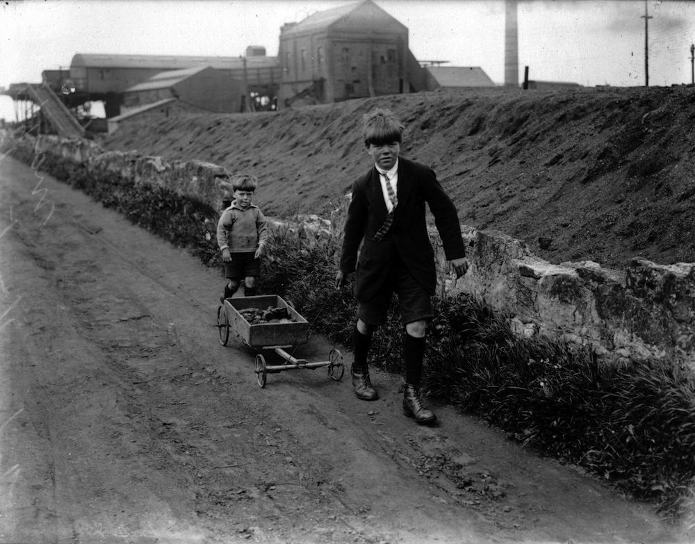 May 1926: Boys bring home the family coal rations from a colliery near Edinburgh, during the General Strike of 1926. (Photo by Central Press/Getty Images)