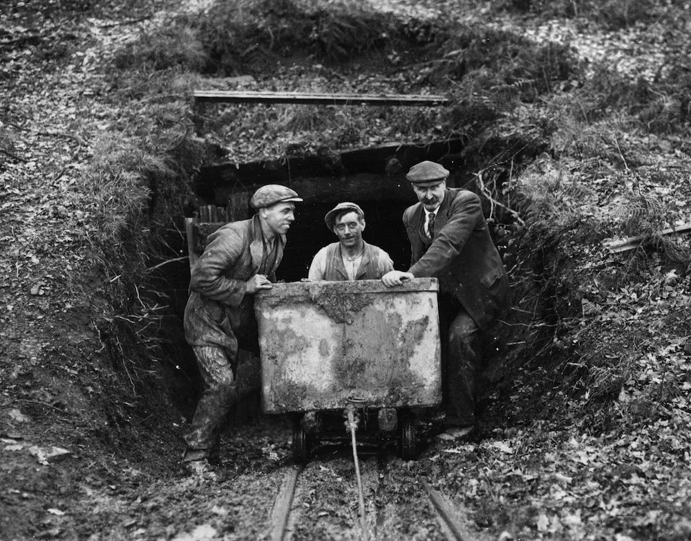 circa 1930:  Miners bring out coal out from a small privately owned mine in the Forest of Dean.  (Photo by Fox Photos/Getty Images)