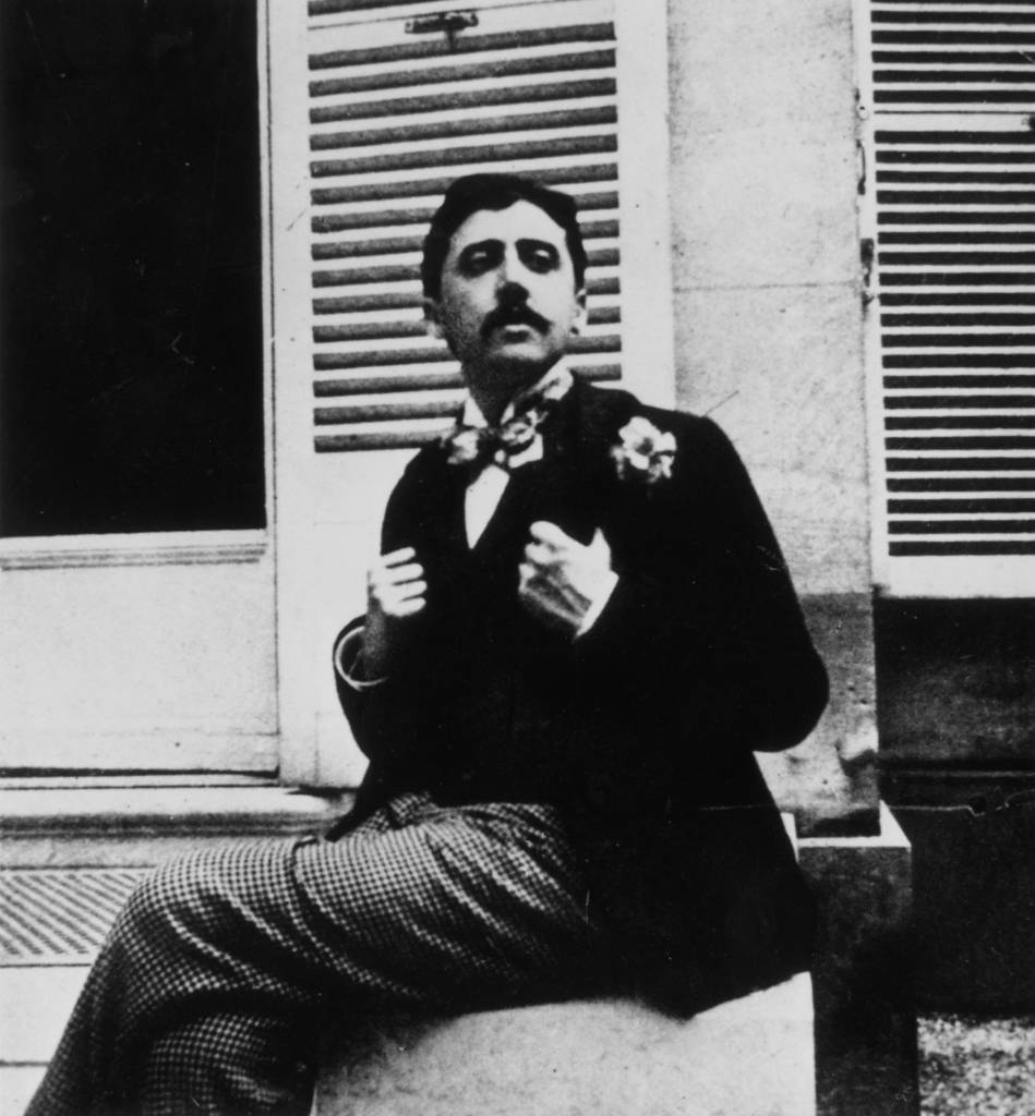 circa 1910: French author Marcel Proust (1871 - 1922) sitting outside a window. (Photo by Hulton Archive/Getty Images)