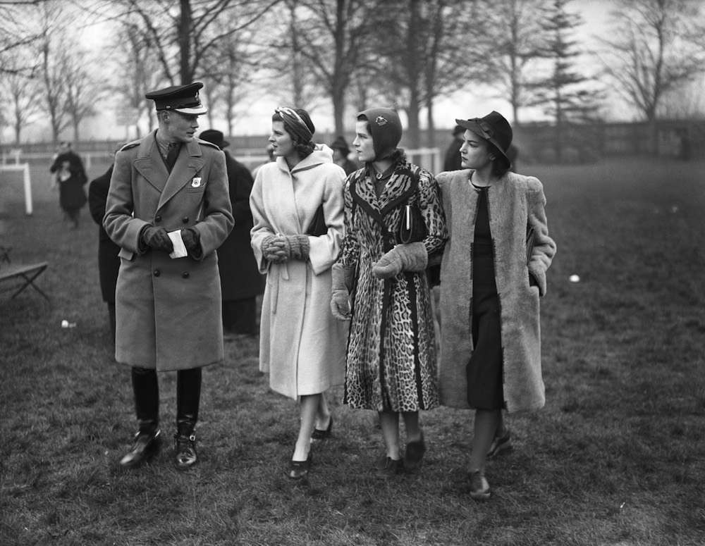 Spectators at the Boxing Day steeplechase meeting at Windsor Racecourse, Berkshire, 26th December 1939. Left to right: Arthur Valerian Wellesley (later 8th Duke of Wellington), Diana Norton, Osla Benning (died 1974) and English actress June Duprez (1918 - 1984). (Photo by Fox Photos/Hulton Archive/Getty Images)