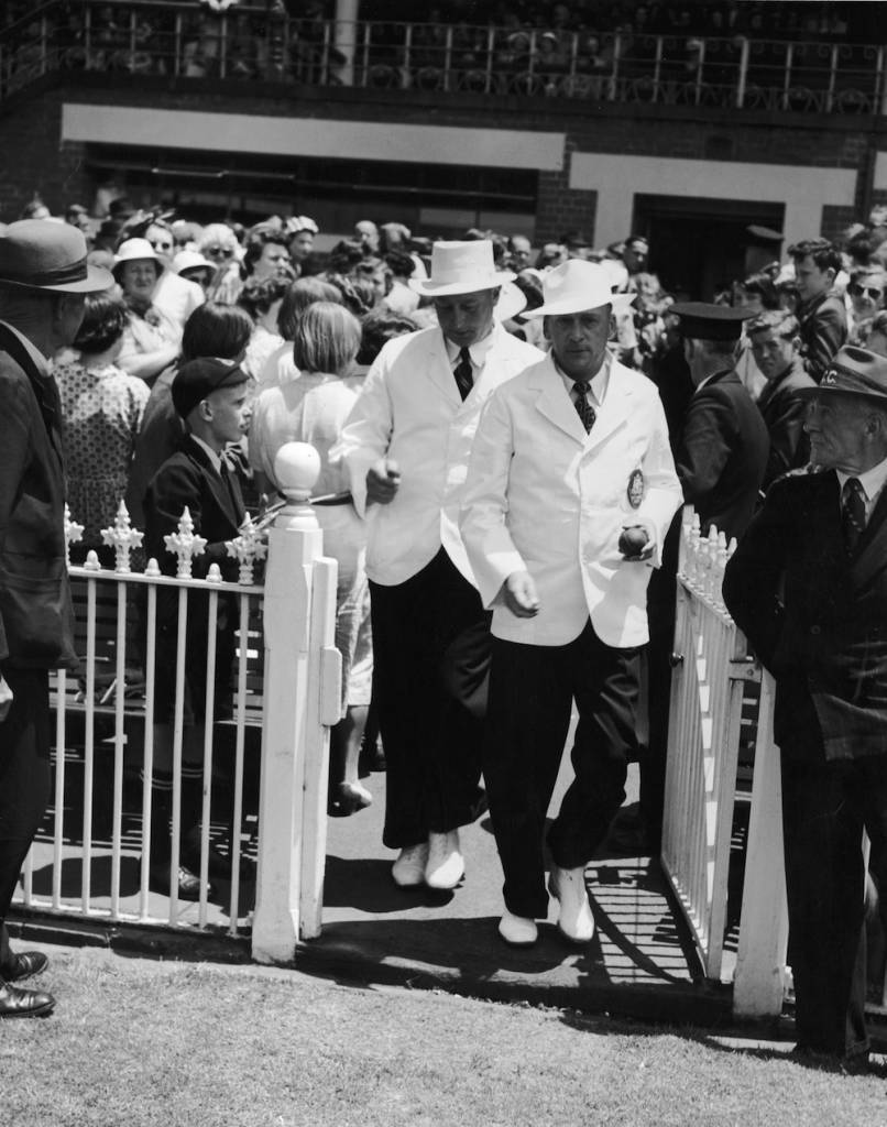 Umpires, Wright (left) and Cooper going out for Boxing Day's play during the 2nd Test Match between England and Australia at Melbourne, 26th December 1950. (Photo by Central Press/Hulton Archive/Getty Images)